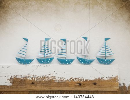 Maritme old wooden background with five boats.