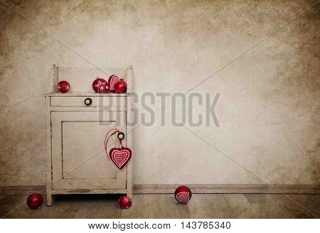 Red christmas balls on a old cupboard for decoration items on vintage background.