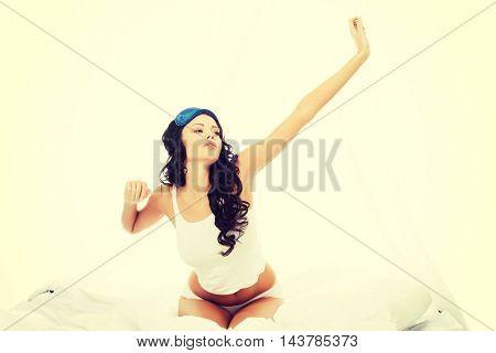 Beautiful smiling woman stretching