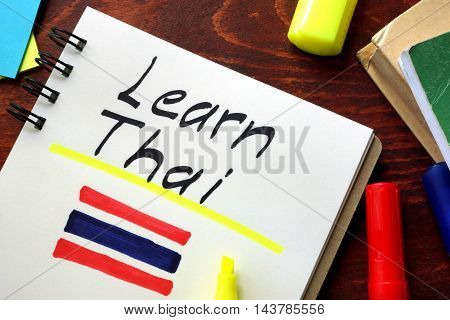 Learn thai written in a notepad.  Education concept.