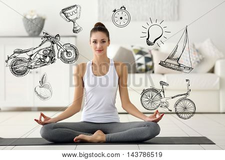 Beautiful young woman sitting in lotus pose on mat at home. Sport lifestyle concept. Diversity of sport icons on background.