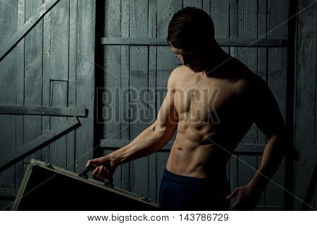 Muscular Boy With Suitcase