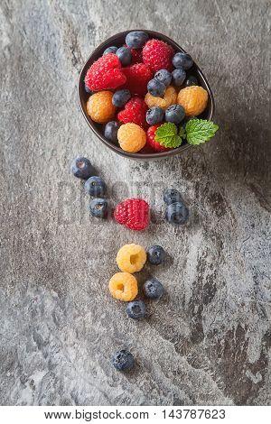 Ripe Berries. White, Red Raspberries And Blueberries In Brown Bo