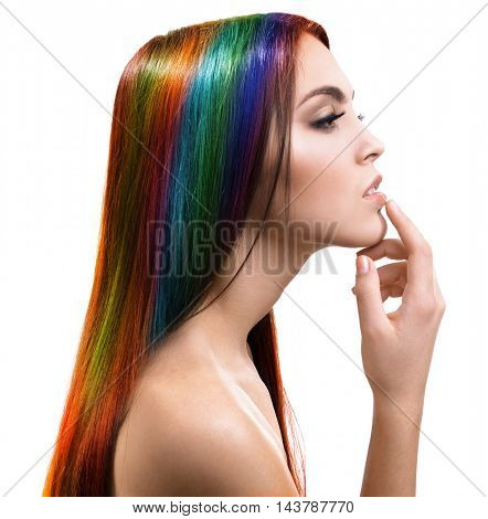 Beautiful young woman with colorful hair on white background