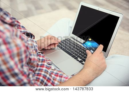 Man hands using credit card and laptop for online shopping