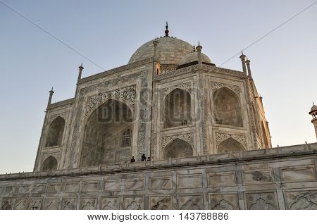 AGRA, INDIA - AUG 9 2010: A side view of the world famous Taj Mahal, showing the intricate details of the marble.
