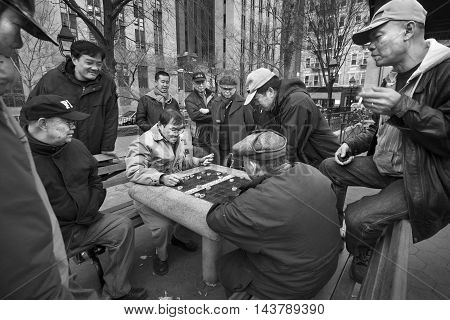 NEW YORK CITY, NEW YORK - April 4 2011: A game of Chinese checkers in a public park with onlookers.