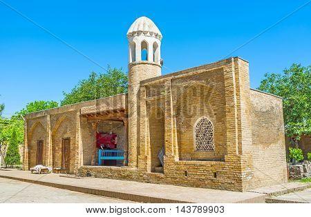 The small minaret of Mosque of Hazrat Imam Complex Shakhrisabz Uzbekistan.