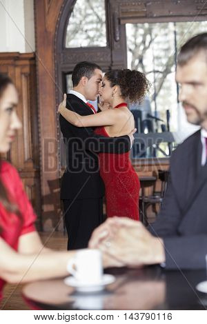 Tango Dancers Performing While Couple Sitting In Restaurant