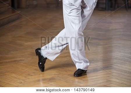 Low Section Of Dancer Performing Tango At Restaurant
