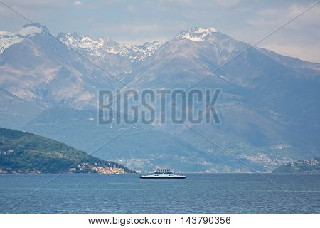 Ferry at Lake Como on the background of mountains