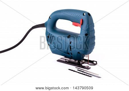 isolated blue fretsaw on white background photo