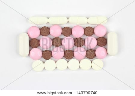 the different medicinal pills on white background