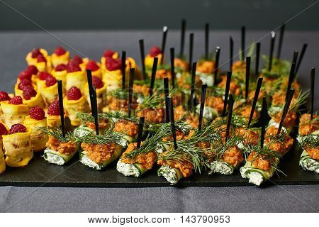 Delicious canapes as event dish on a plate