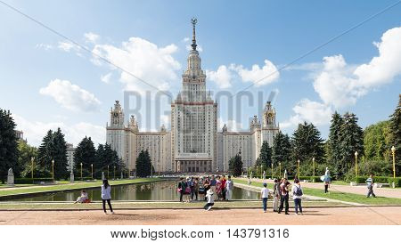 Moscow - August 11 2016: Moscow State University named after Lomonosov on the Sparrow Hills and tourists are photographed in fine weather August 11 2016 Moscow Russia