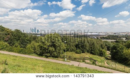 Moscow - August 11 2016: View from the observation deck on the Sparrow Hills and the skyscrapers of Moscow City and the Luzhniki Stadium away August 11 2016 Moscow Russia