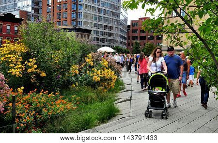 New York City - August 3 2013: People strolling along the High Line Park built on a historic elevated freight train rail line on the West Side of Manhattan