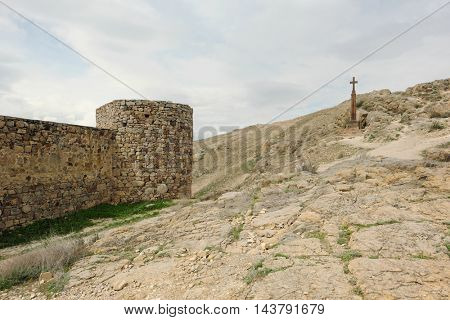 Christian cross near ancient monastery Khor Virap in the mountains of Armenia. Was founded in years 642-1662.