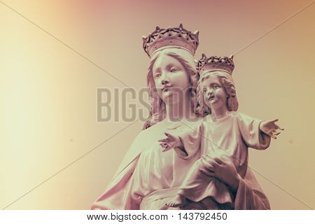 Virgin Mary and baby Jesus  ( Filtered image processed vintage effect. )