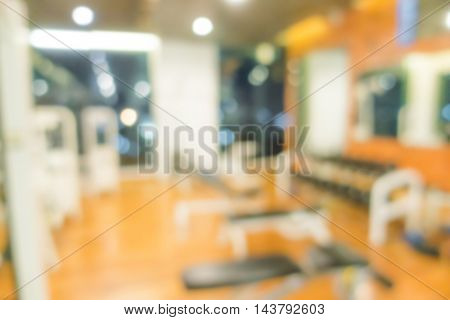 Abstract blur Fitness center with traineger equipments
