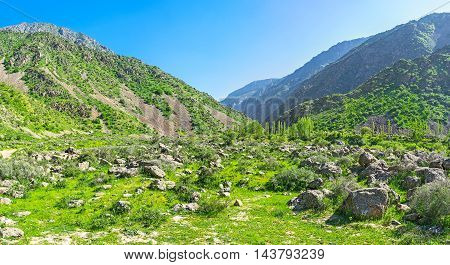 The giant boulders in Zarmas gorge in Gissar Range of Pamir-Alay the Nature Reserve is the perfect place for active tourists Uzbekistan.