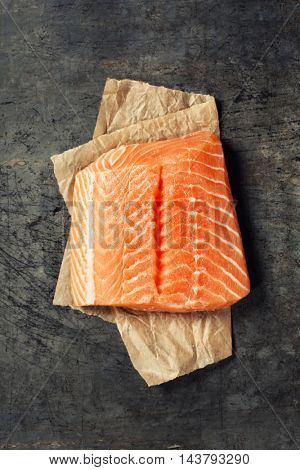 Raw salmon fillet  in a rustic style. Top view