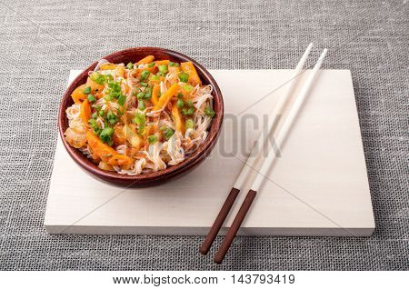 Asian Dish Of Rice Noodle And Vegetable Seasonings
