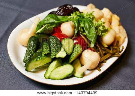 Raw marinated vegetables on a baking tray ready for roasting, selective focus