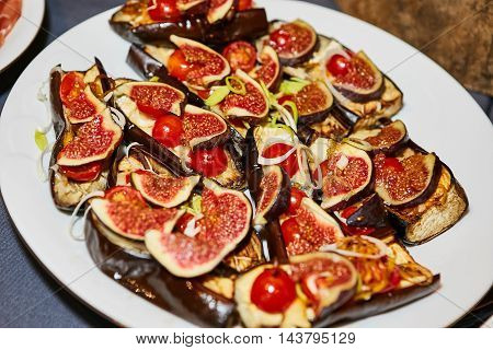 Extreme Close Up of Bounty of Colorful Grilled Vegetables and Dish of Olives