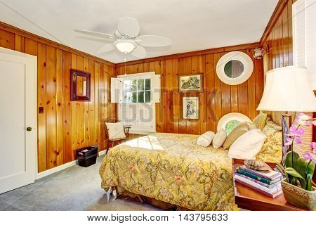 Craftsman Bedroom Interior With Wooden Pannel Walls.