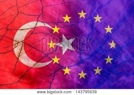 EU and Turkish flag on crack background
