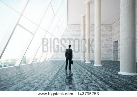 Businessman with briefcase standing in interior design with concrete columns panoramic city view and daylight. 3D Rendering