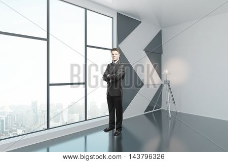 Businessman standing in interior with patterned black-and-white wall floor lamp and window with city view. Side view 3D Rendering