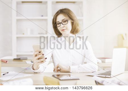 Woman Using Smartphone And Other Devices