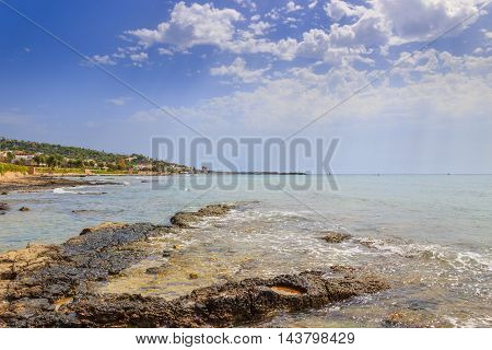Salento coast, Ionian sea:panoramic view of Torre Vado town.Italy (Apulia).In the background the beach and the tourist port with the watchtower.