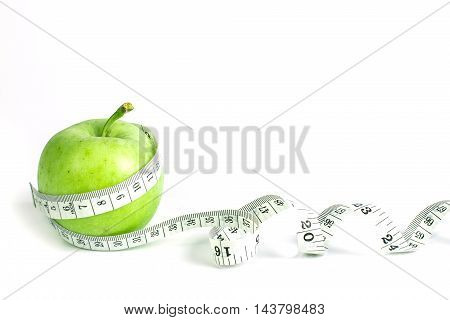the green apple with Measuring tape on white background in concept of healthy and diet