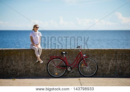 Woman and bike in city