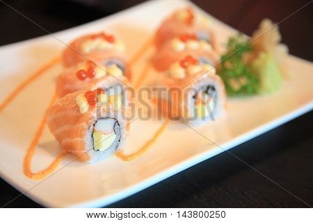 Salmon Sushi Rolls And Spicy Sauce