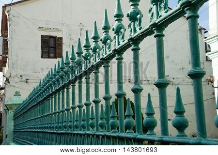 Phot of the Metal wrought forged fence in perspective closeup. Security protection concept.