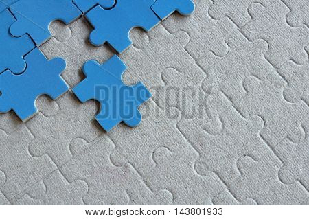 Group of jigsaw puzzle on a paper