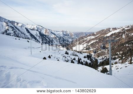 The cable car in the snowy mountains Chimbulak photo for you