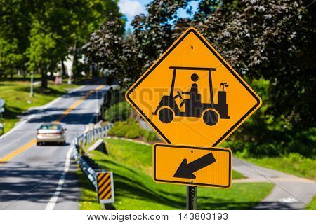 Hershey PA - August 22 2016: A golf cart crossing warning sign for motorists on a road in Hershey.