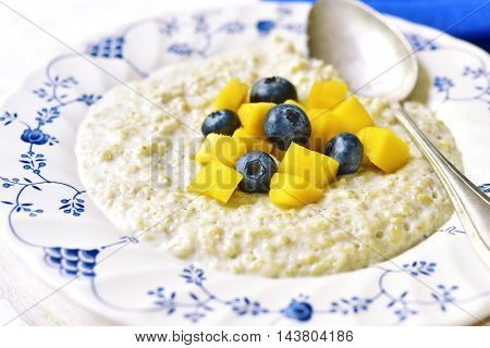 Oat Porridge With Mango And Blueberry For A Breakfast.