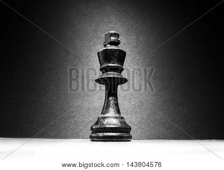 One mighty king chess piece in center