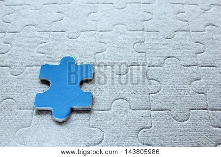 Close-up of alone jigsaw on a paper