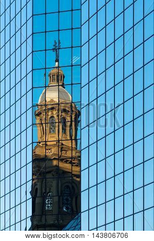 Reflection of the Metropolitan Cathedral in a glass wall in Plaza de Armas Santiago