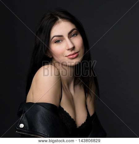 Portrait of beautiful brunnette model woman showing her delicake skin. Lady with beautiful smile posing for photographer in studio.