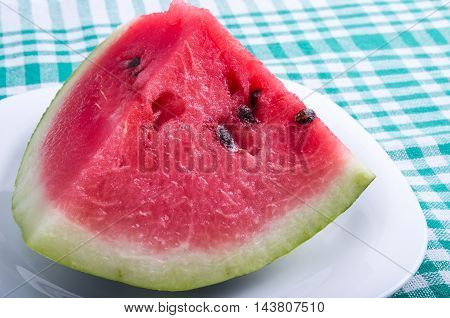 Close Up View On A Large Piece Of Watermelon Red