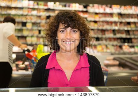 Woman Buying Frozen Fish, Groceries In A Supermarket Or Grocery Store