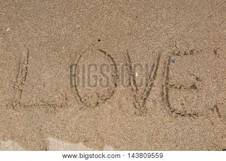 The Word Love On Beach With Wave